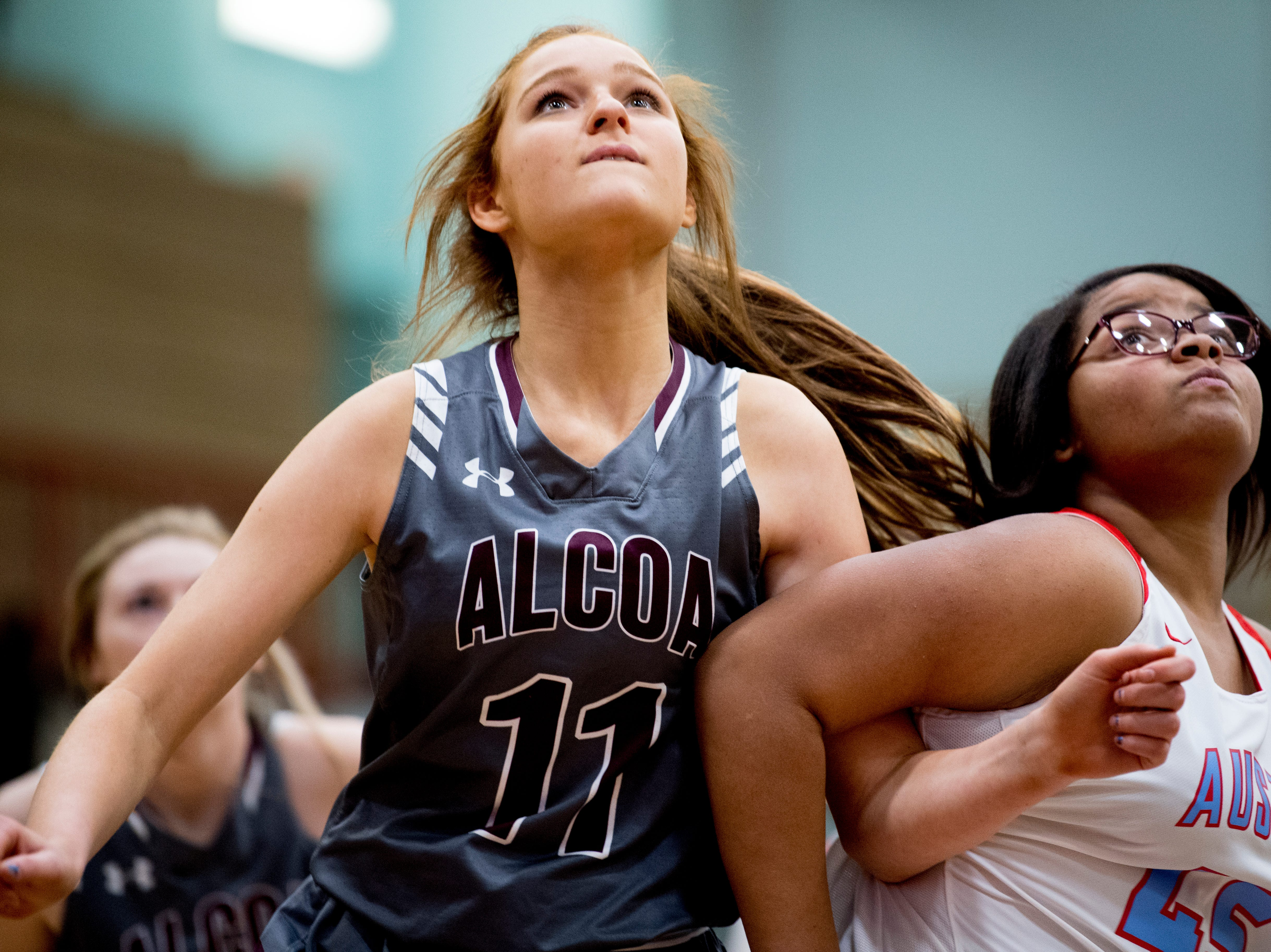 Alcoa's Caleigh Carruthers (11) and Austin-East's India Robinson (45) eye the rebound ball during a game between Austin-East and Alcoa at Austin-East High School in Knoxville, Tennessee on Friday, January 18, 2019.