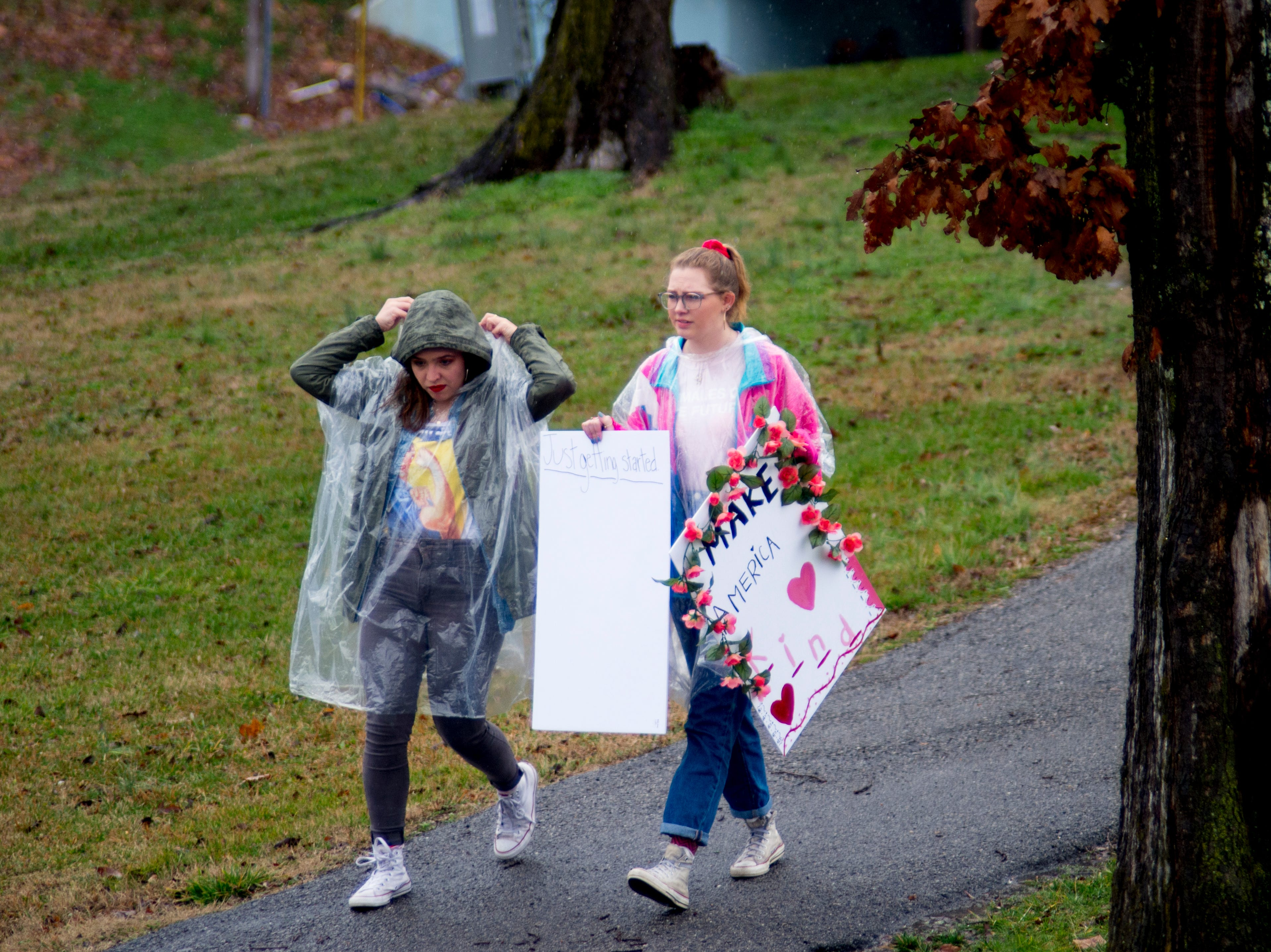Demonstrators walk through the rain at the 2019 Knoxville Women's March at Chilhowee Park in Knoxville, Tennessee on Saturday, January 19, 2019.