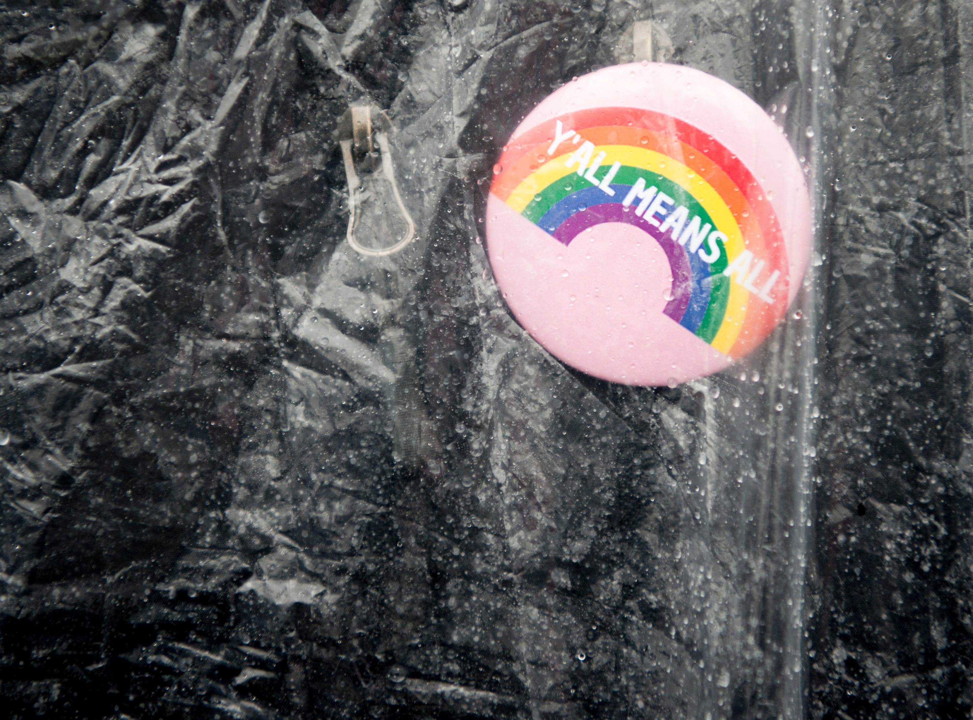 """A demonstrator wears a """"Y'all Means All"""" pin at the 2019 Knoxville Women's March at Chilhowee Park in Knoxville, Tennessee on Saturday, January 19, 2019."""
