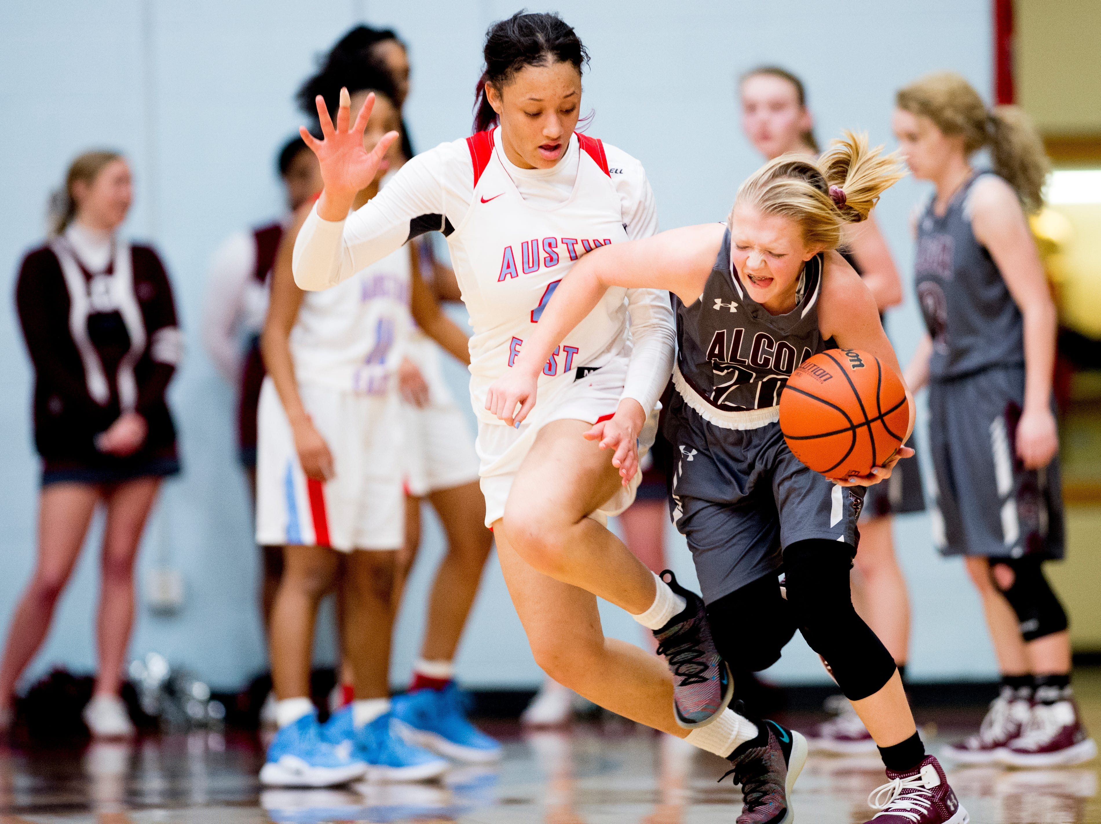 Austin-East's Larriana Bullard (4) defends against Alcoa's Alexis Marshall (20) during a game between Austin-East and Alcoa at Austin-East High School in Knoxville, Tennessee on Friday, January 18, 2019.