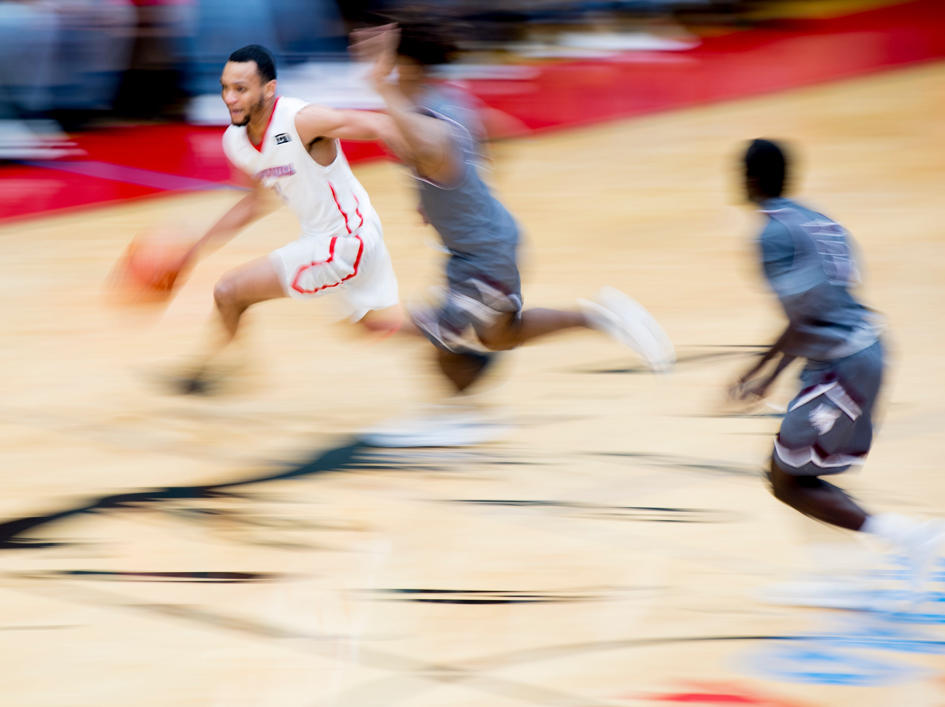 Austin-East's Ronney Pierson (5) dribbles down the court during a game between Austin-East and Alcoa at Austin-East High School in Knoxville, Tennessee on Friday, January 18, 2019.