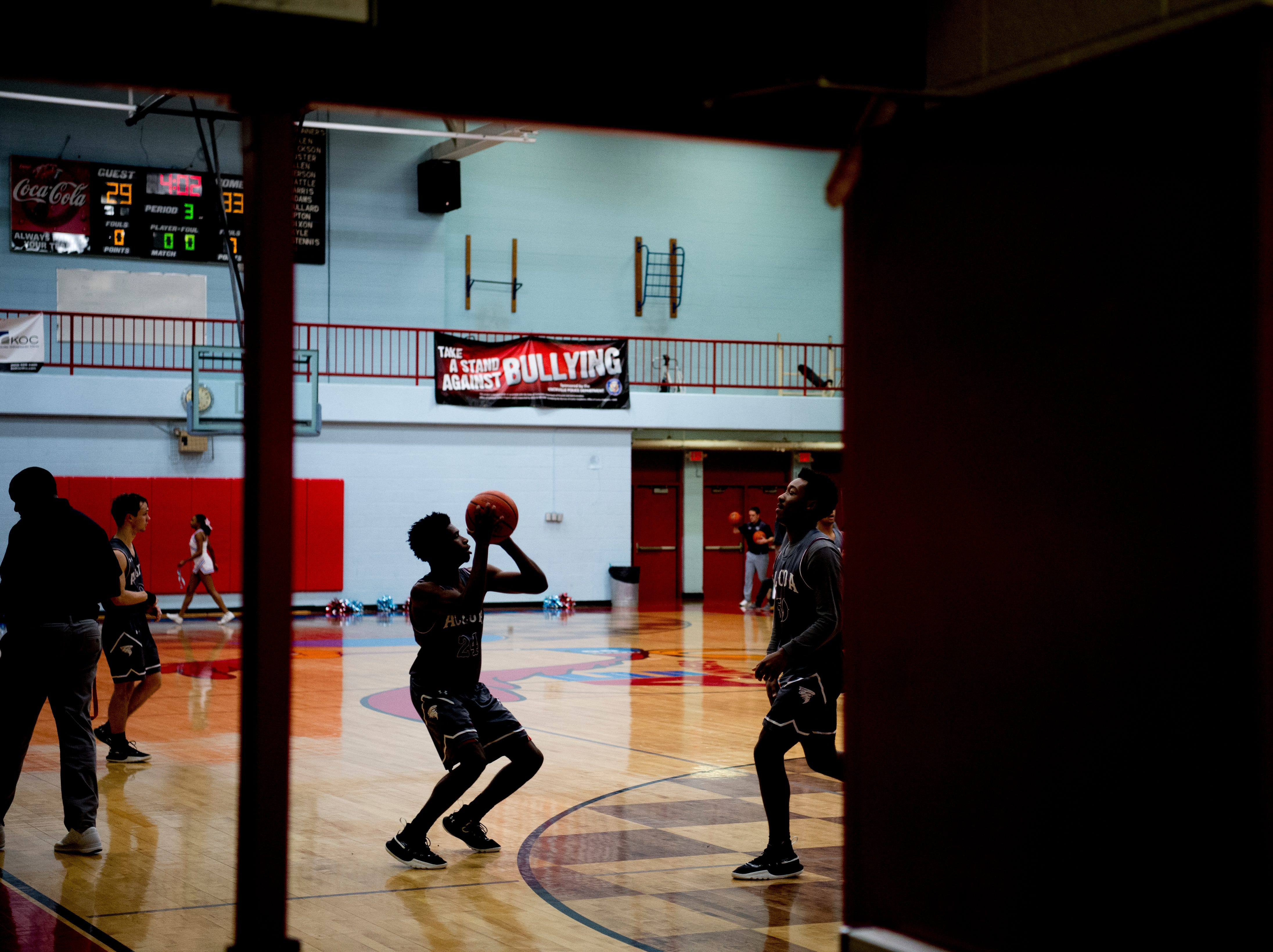 Alcoa players warm up during a game between Austin-East and Alcoa at Austin-East High School in Knoxville, Tennessee on Friday, January 18, 2019.