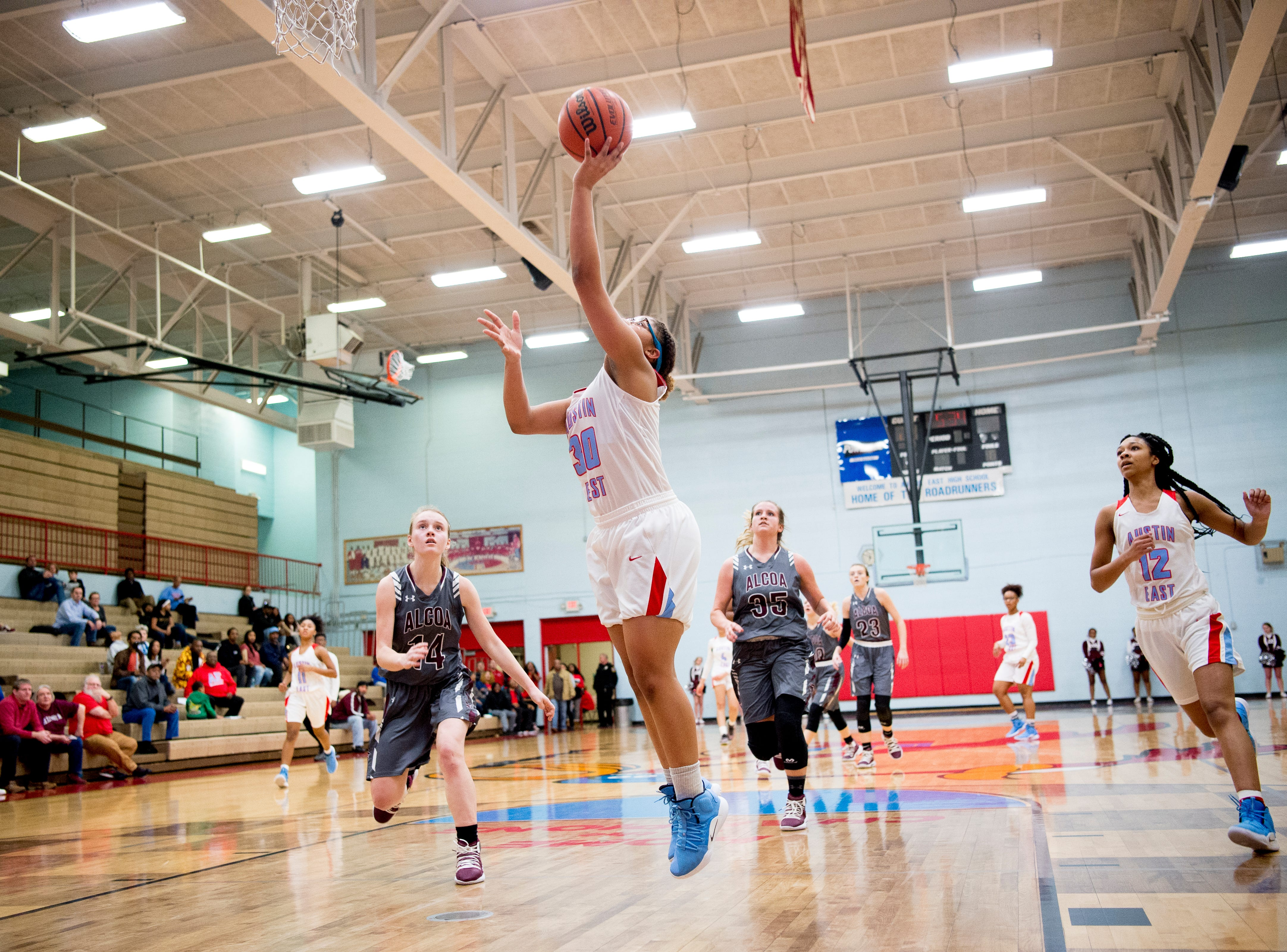 Austin-East's Ahya Moreno (30) shoots a layup during a game between Austin-East and Alcoa at Austin-East High School in Knoxville, Tennessee on Friday, January 18, 2019.