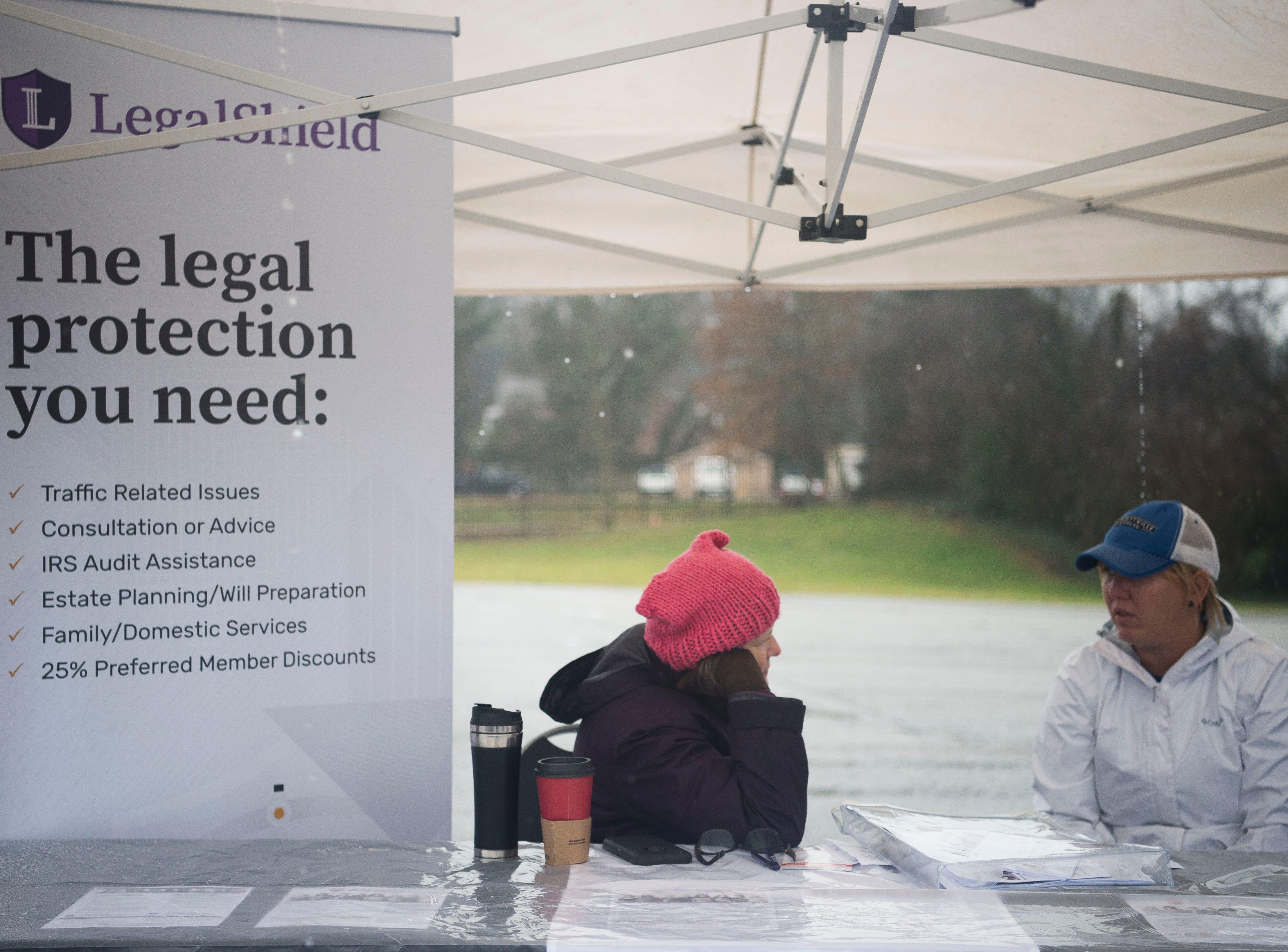 From left Lynda Blankenship and her daughter Lauren chat in the LegalShield booth during the 2019 Women's March in Chilhowee Park Saturday, Jan. 19, 2019.