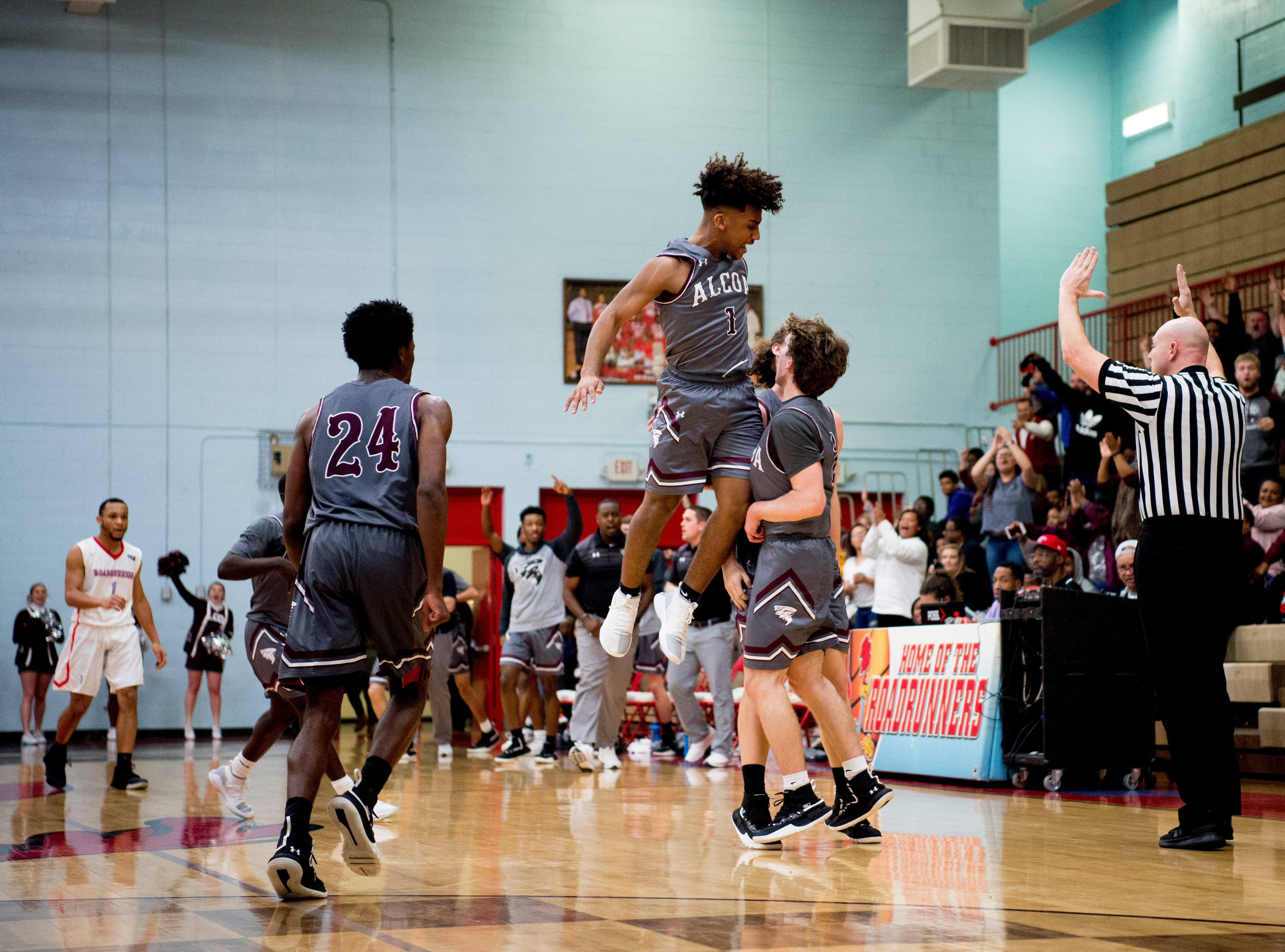 Alcoa's Tyren McNear (1) congratulates Garrett Rogers (2) on his point at the end of the second quarter during a game between Austin-East and Alcoa at Austin-East High School in Knoxville, Tennessee on Friday, January 18, 2019.