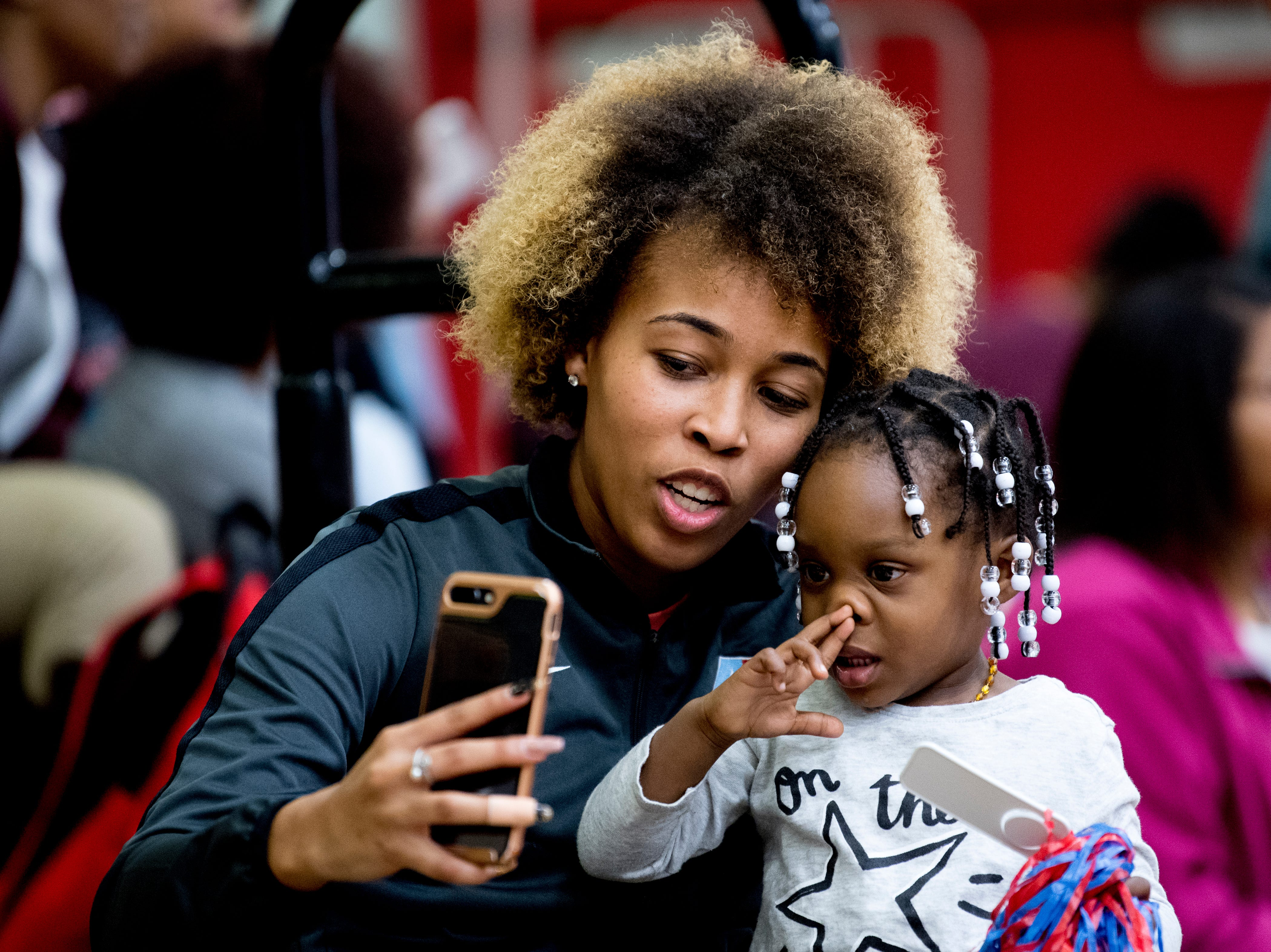 Jalan Harper takes a selfie with Jordynn Crenshaw, 2, in the stands during a game between Austin-East and Alcoa at Austin-East High School in Knoxville, Tennessee on Friday, January 18, 2019.