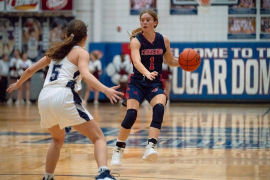 TCH's Lizzy Ratcliff moves the ball down the court as the St. Thomas More Cougars take on the Teurlings Catholic Rebels on January 18, 2019.