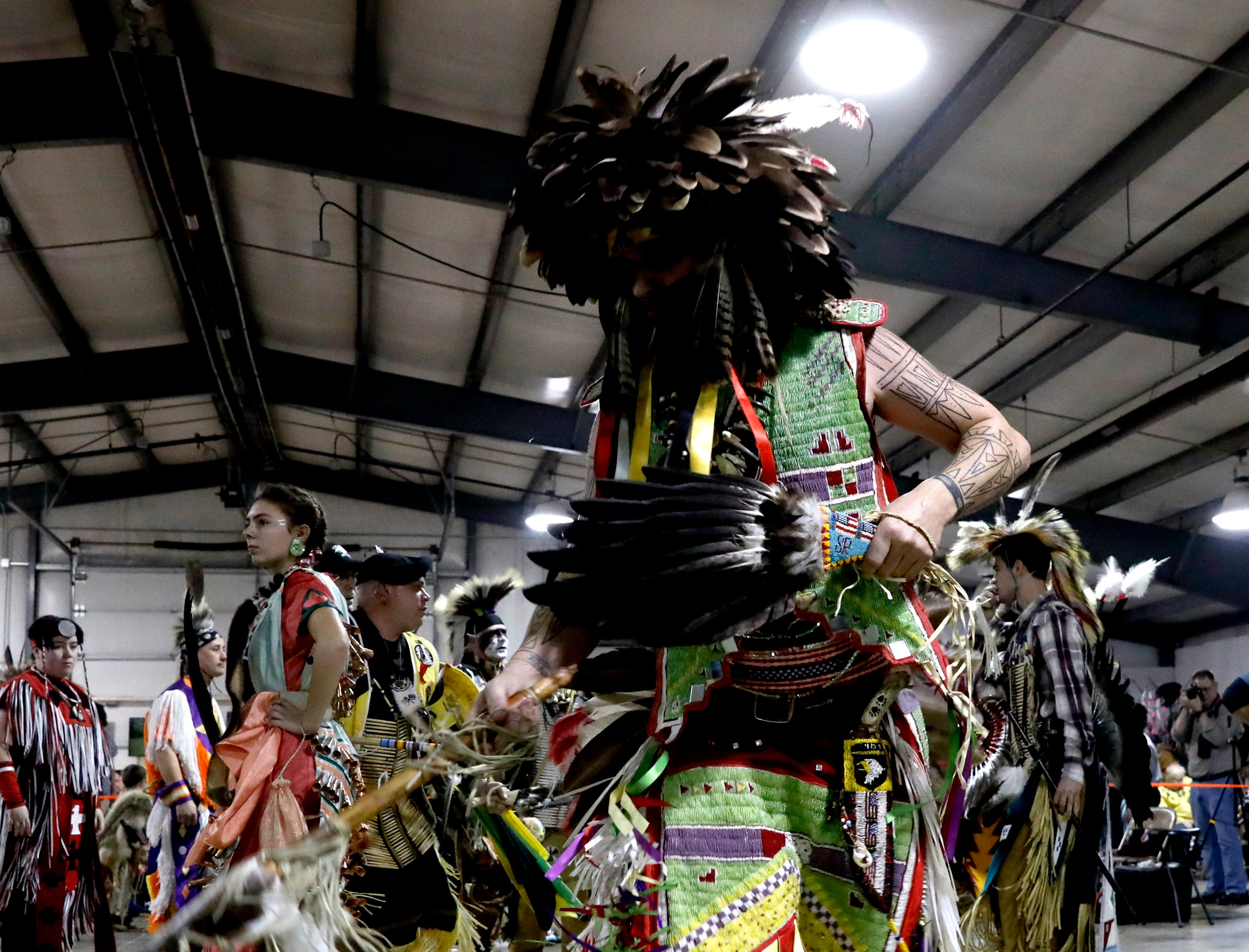 Shawn Reilly, from Newark, dances during one of the intertribal dances Saturday, Jan. 19, 2019, during the Honoring Traditions: An Eastern Woodland Native American Celebration at the Fairfield County Fairgrounds in Lancaster. Hundreds of people gathered at the fairgrounds for the 15th annual event.