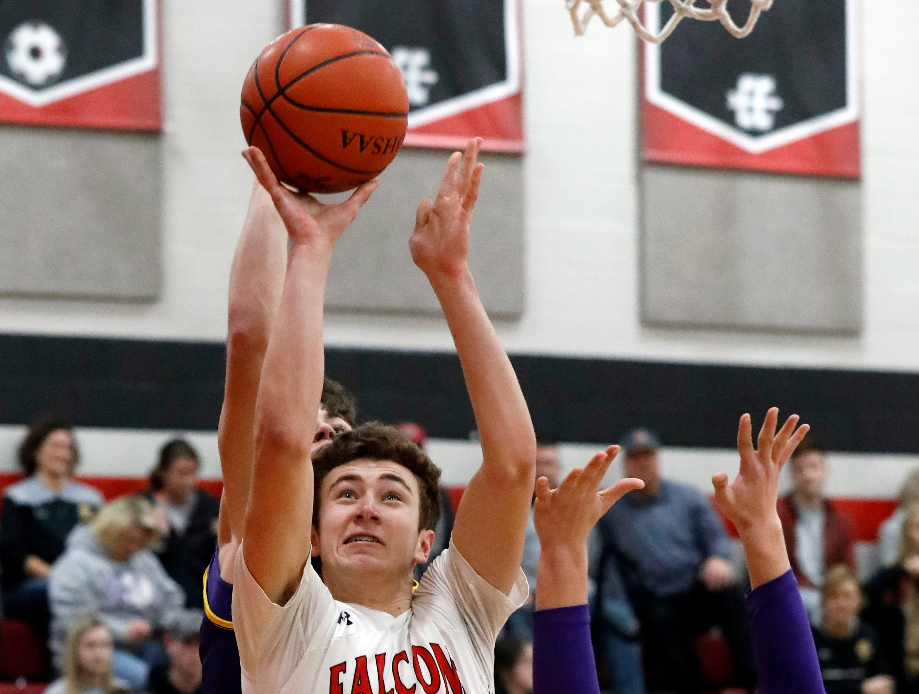 Fairfield Union's Huston Harrah takes shoots the ball during Friday night's game, Jan. 18, 2019, against Bloom-Carroll at Fairfield Union High School in Rushville. The Falcons won the game 42-31.