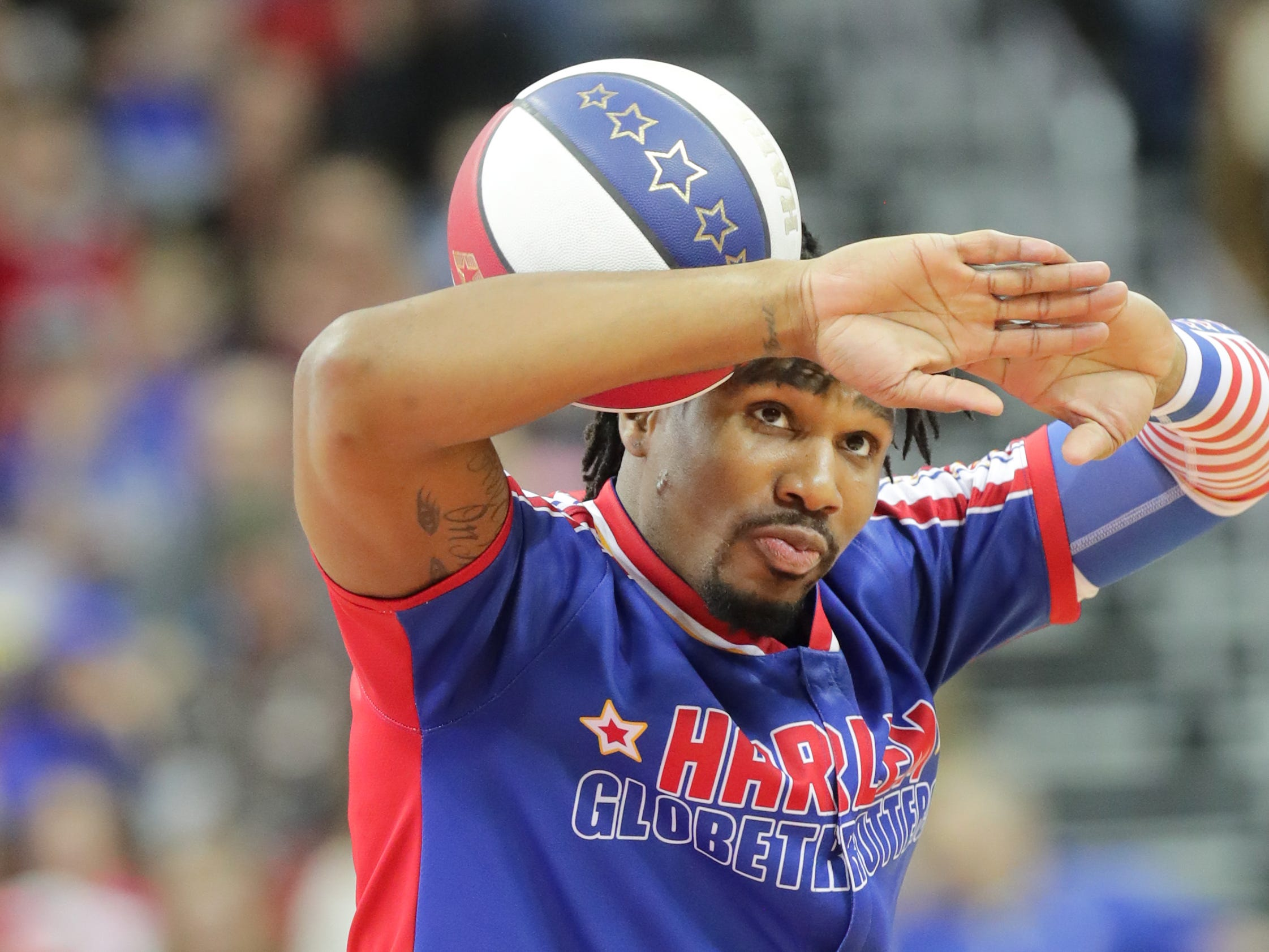 Harlem Globetrotters' Thunder entertains the crowd with his ball control before the game.