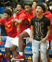 The Seneca bench erupts in celebration as their team edges Ballard, 61-59, in a back-and-forth semifinal game of the Boys Louisville Invitational Tournament. Jan. 18, 2019