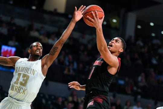 Louisville guard Christen Cunningham shoots as Georgia Tech guard Curtis Haywood II (13) defends during the first half of an NCAA college basketball game Saturday, Jan. 19, 2019, in Atlanta.
