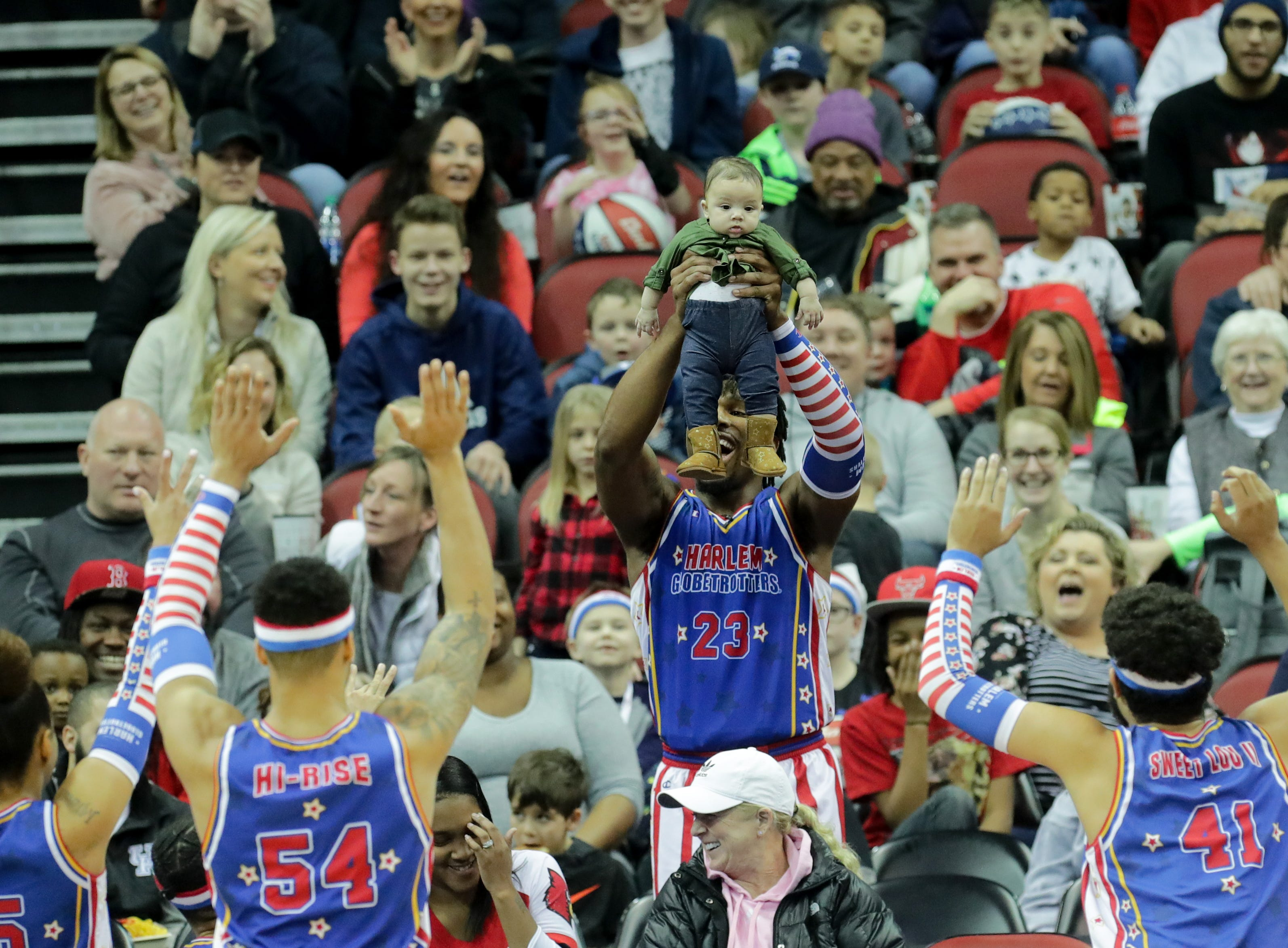 Harlem Globetrotters' Thunder remakes a scene from The Lion King by holding up a baby for the audience.Jan. 19, 2019