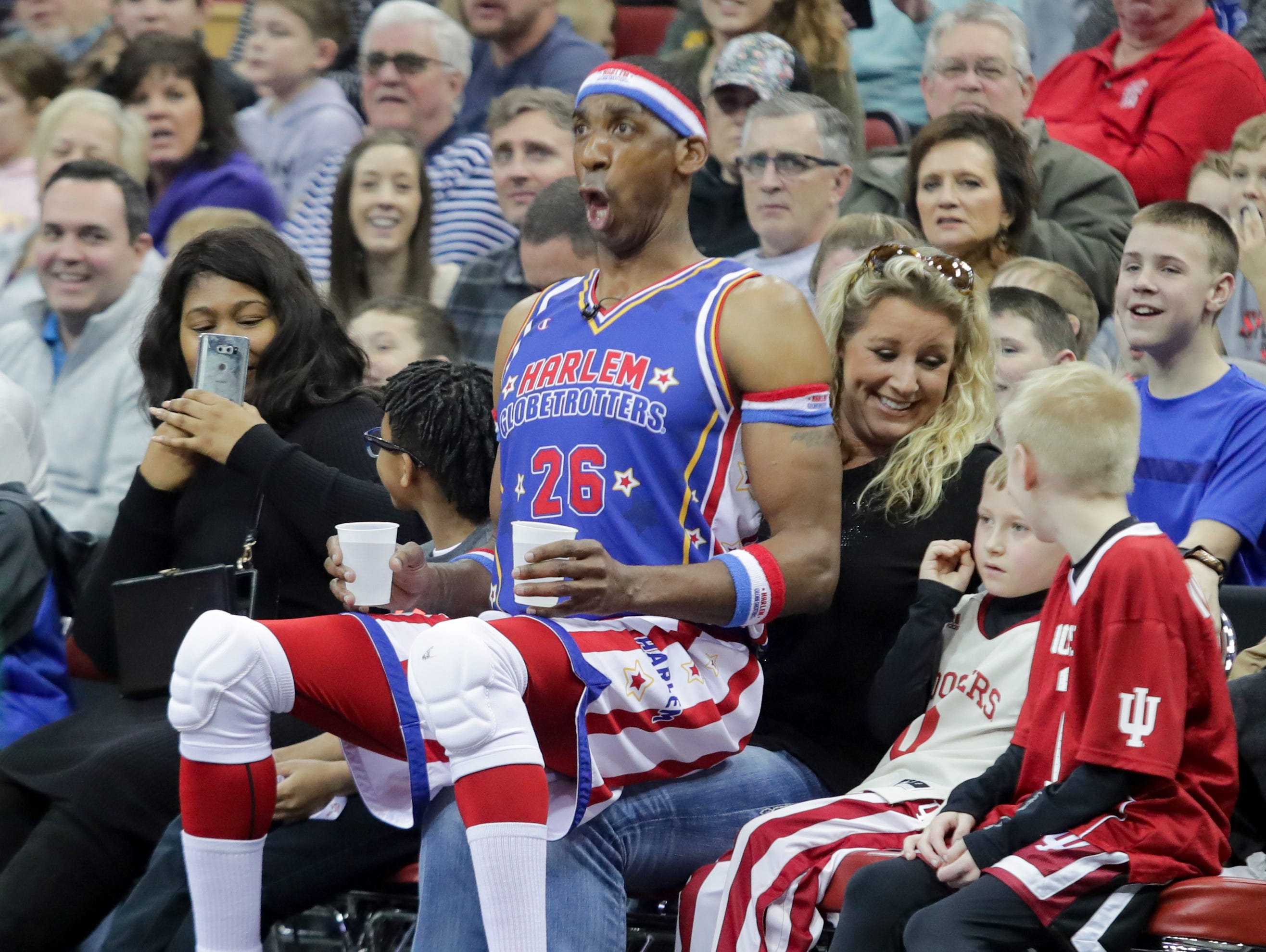 Harlem Globetrotters' Hi-Lite waits on a fan during free throws.