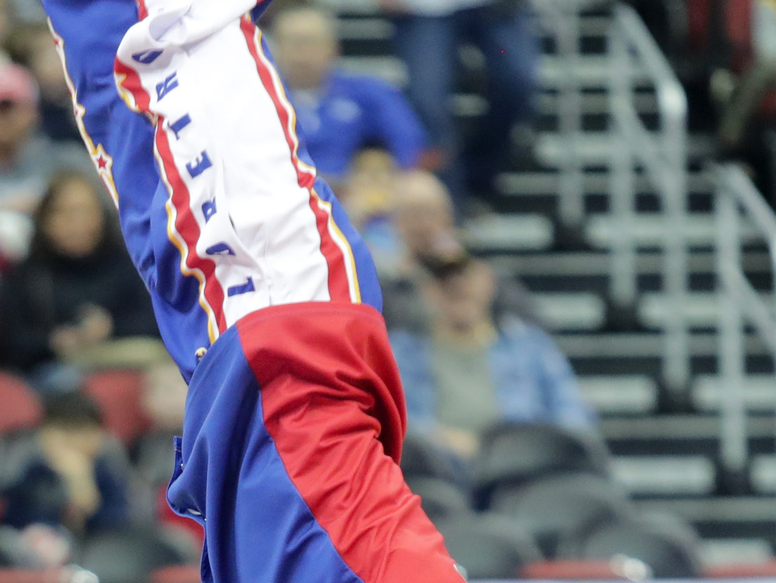 Harlem Globetrotters' Wham entertains the crowd with his ball control before the game.