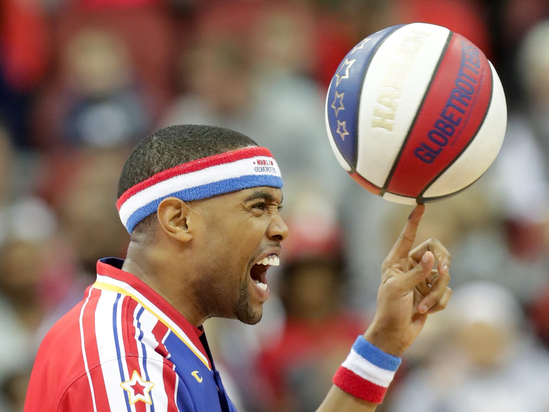 Harlem Globetrotters' Cheese entertains the crowd with his ball control before the game.