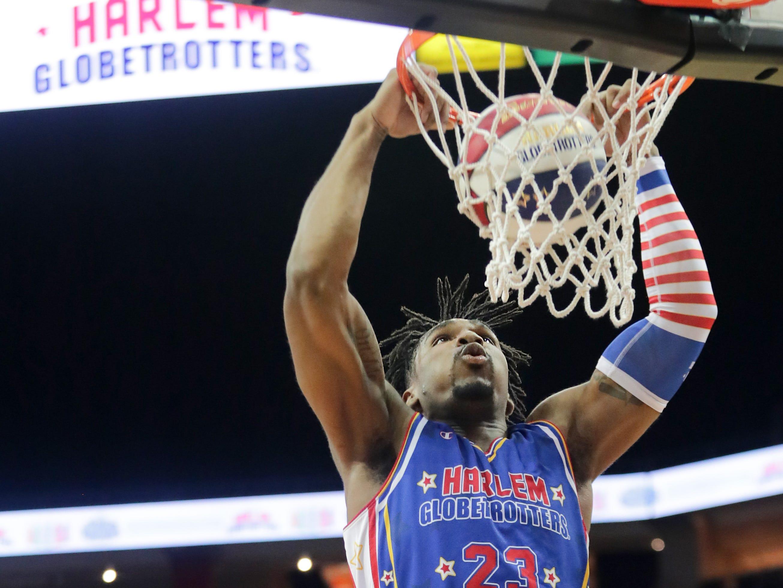 Harlem Globetrotters' Thunder with the slam dunk.