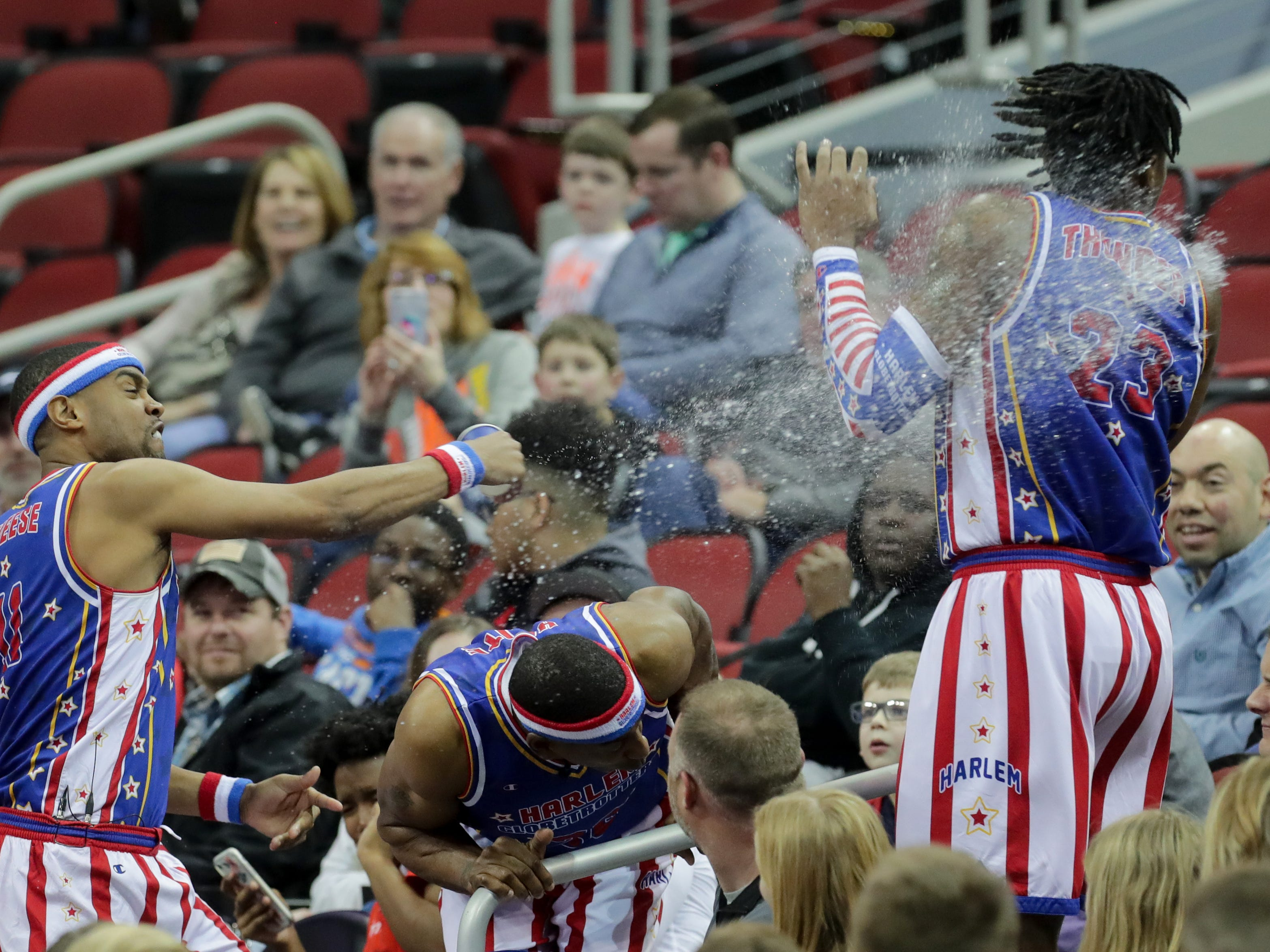 Harlem Globetrotters' Cheese sprays Thunder with water.