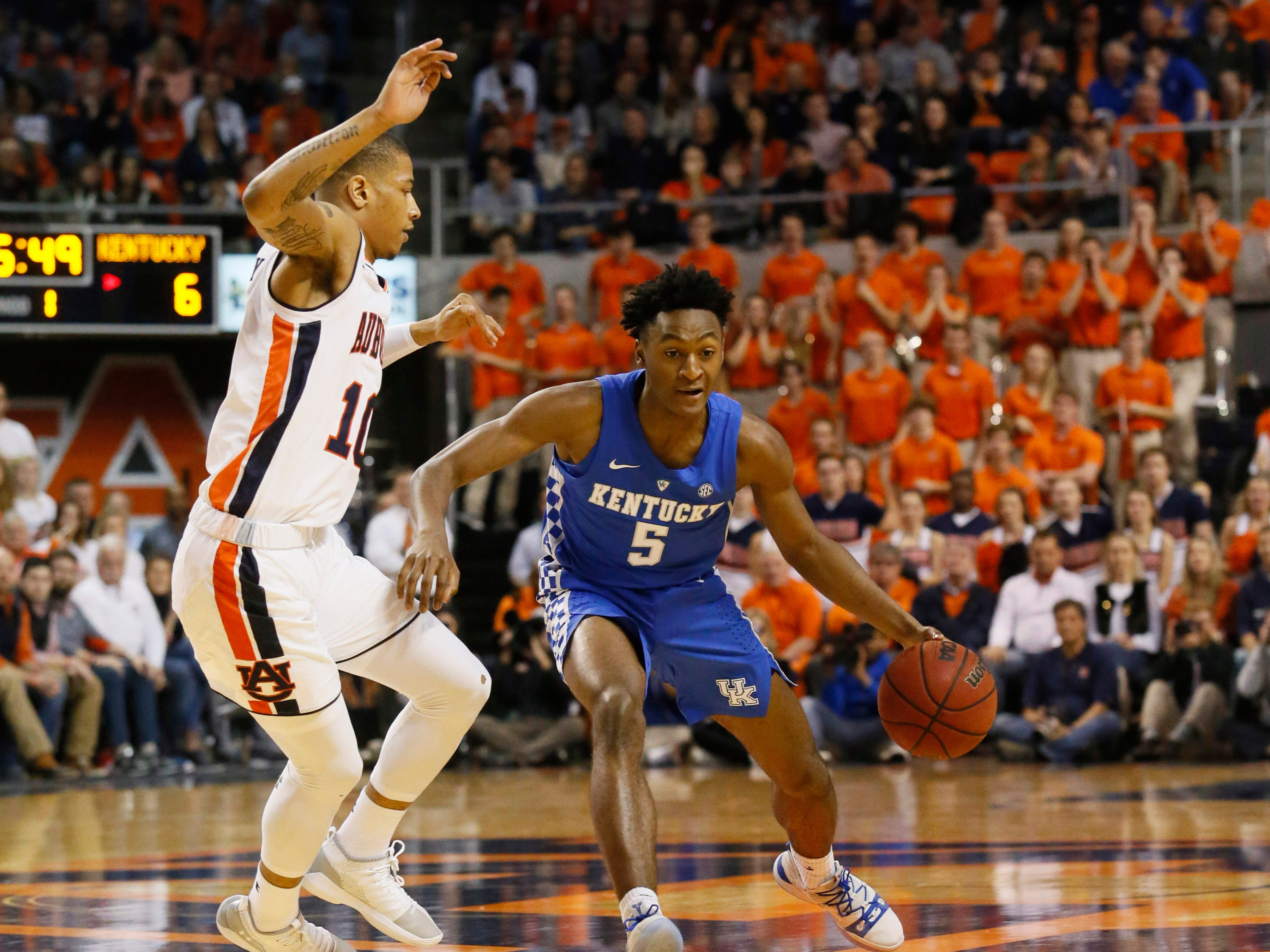 Kentucky Wildcats guard Immanuel Quickley (5) is pressured by Auburn Tigers guard Samir Doughty (10) during the first half at Auburn Arena in Auburn, Alabama, on Saturday, Jan. 19, 2019.