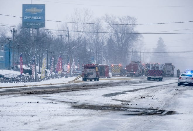 Police and fire departments are at the scene of a fire at Sundance Chevrolet in Grand Ledge Saturday, Jan. 19, 2019.