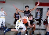 See some of the action from Okemos' key CAAC Blue win over DeWitt.