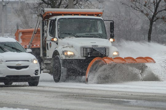 City of Lansing snow plows and salt trucks are out in force Saturday morning, Jan. 19, 2019 after an overnight snowfall.