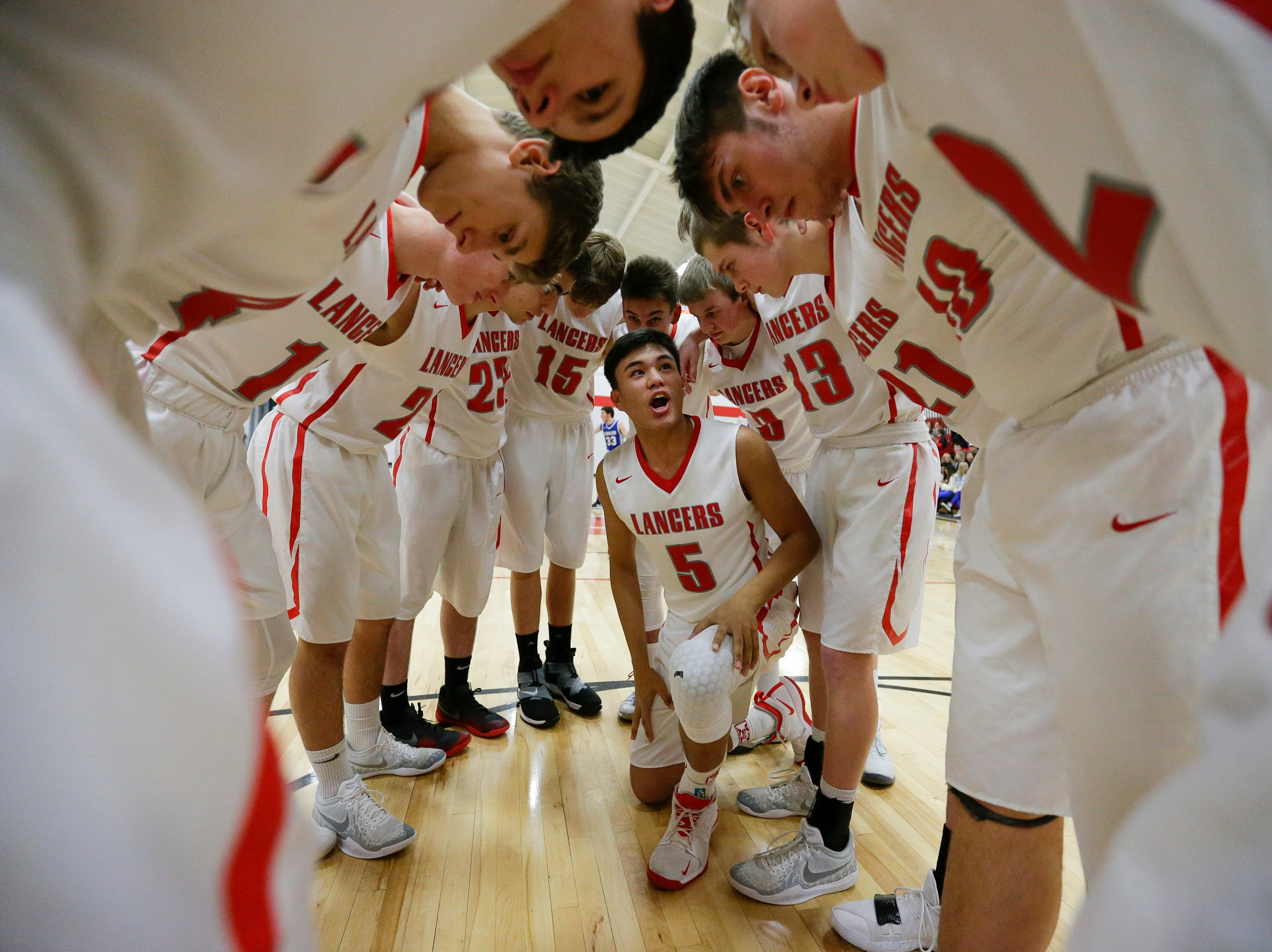 Manitowoc Lutheran's Santana Lomibao (5) rallies his teammates before their game against Kohler at Manitowoc Lutheran High School Friday, January 18, 2019, in Manitowoc, Wis. Joshua Clark/USA TODAY NETWORK-Wisconsin
