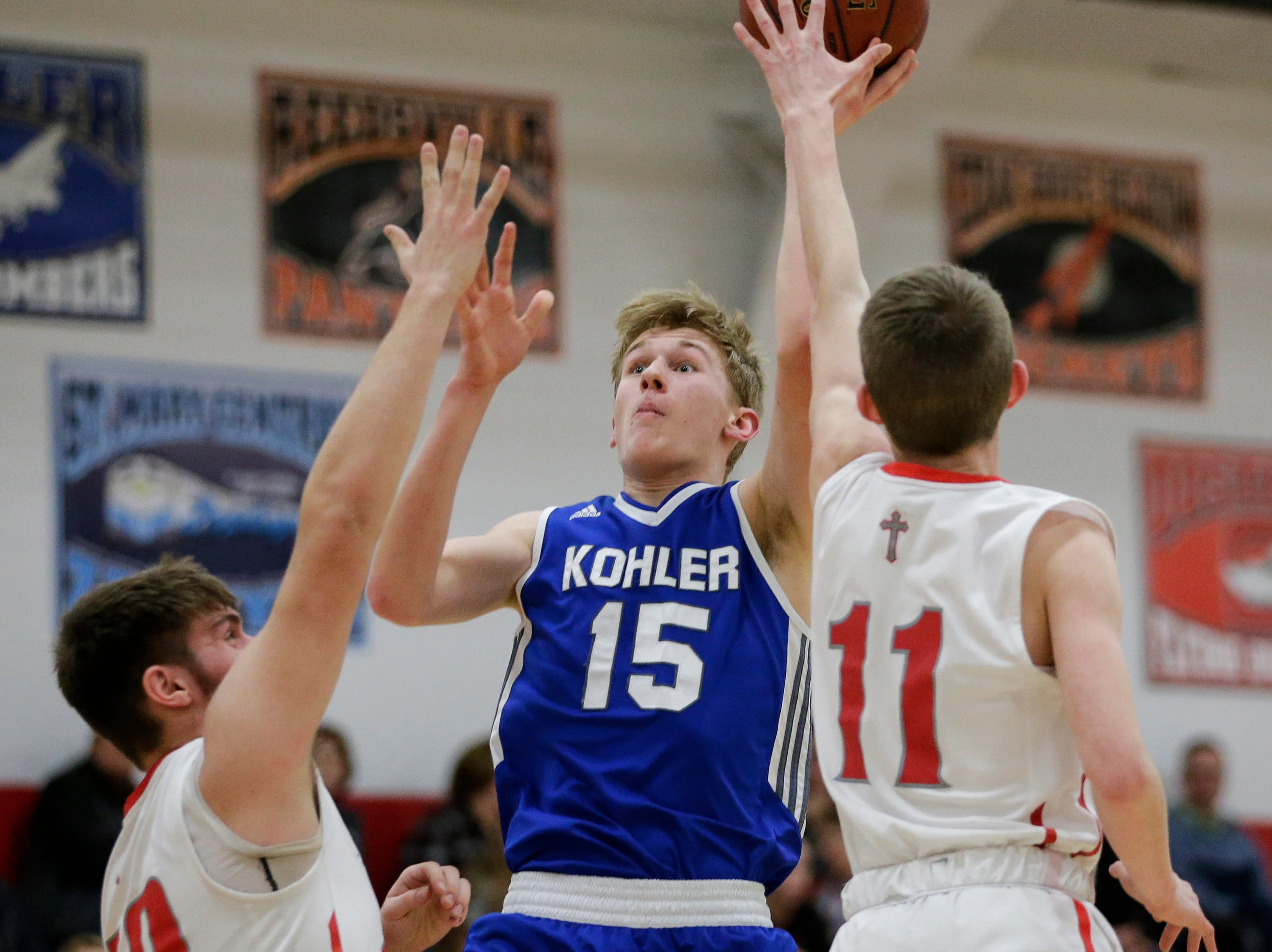 Kohler's Tyler Roeder shoots against Manitowoc Lutheran at Manitowoc Lutheran High School Friday, January 18, 2019, in Manitowoc, Wis. Joshua Clark/USA TODAY NETWORK-Wisconsin