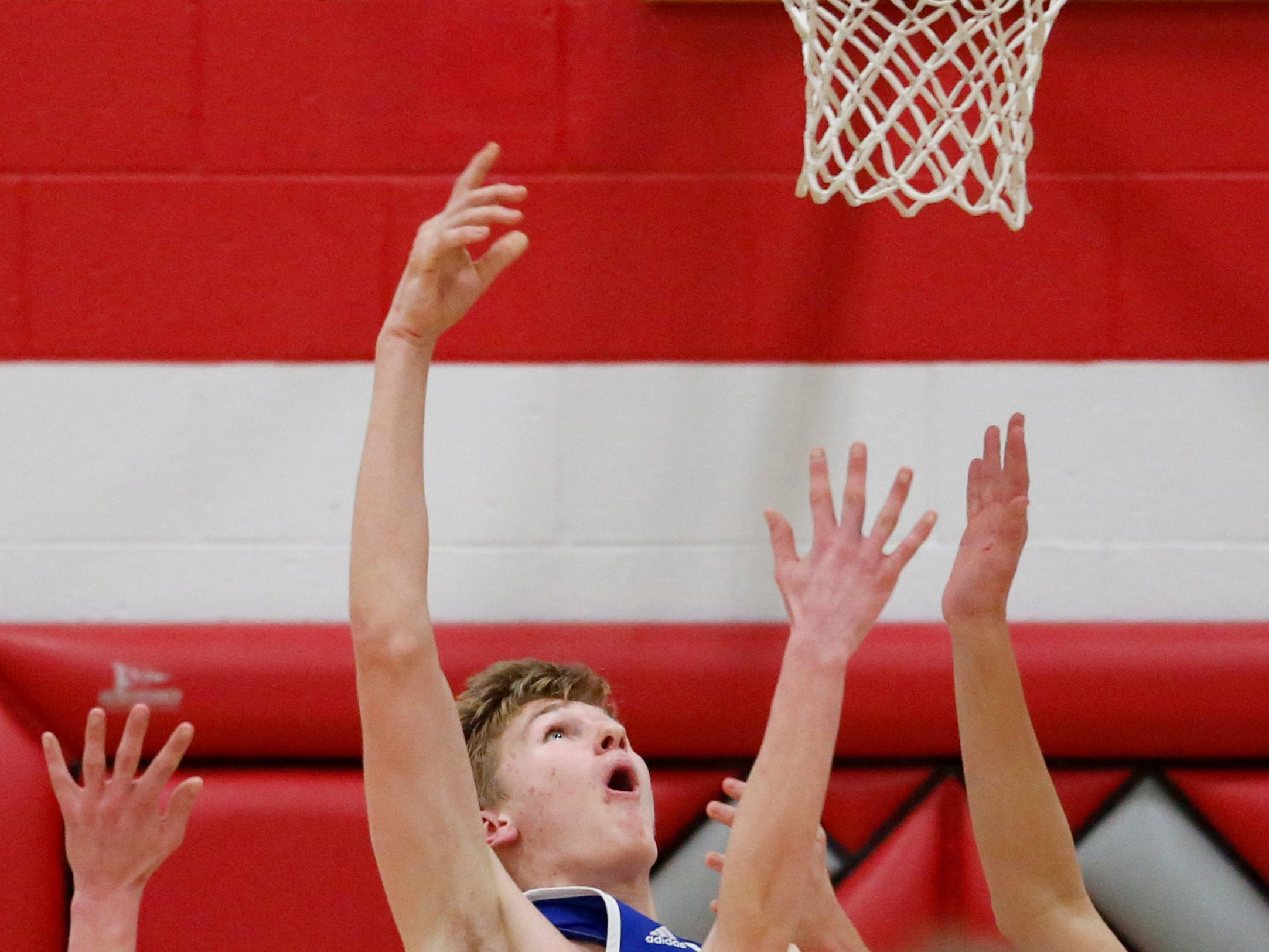 Kohler's Tyler Roeder (15) puts up a reverse layup against Manitowoc Lutheran at Manitowoc Lutheran High School Friday, January 18, 2019, in Manitowoc, Wis. Joshua Clark/USA TODAY NETWORK-Wisconsin
