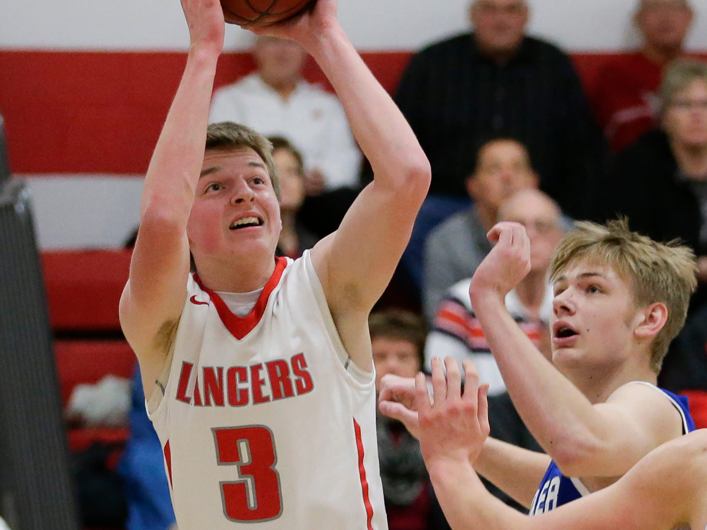 Manitowoc Lutheran's Trey Zastrow shoots against Kohler at Manitowoc Lutheran High School Friday, January 18, 2019, in Manitowoc, Wis. Joshua Clark/USA TODAY NETWORK-Wisconsin