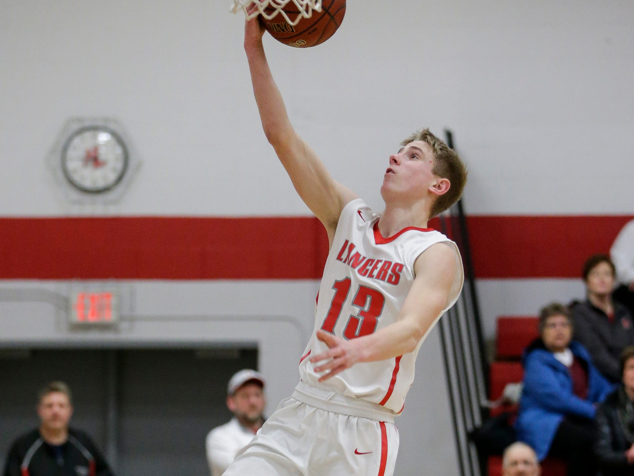 Manitowoc Lutheran's Evan Lischka (13) drives for a layup against Kohler at Manitowoc Lutheran High School Friday, January 18, 2019, in Manitowoc, Wis. Joshua Clark/USA TODAY NETWORK-Wisconsin