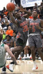 Mansfield Senior's Tavion Harris attempts a shot while playing at Madison earlier in the season.