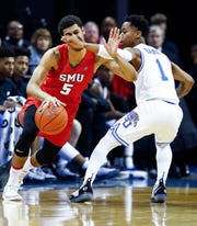 Memphis guard Tyler Harris (right) defensive pressure to SMU guard Nat Dixon (left) during action at the FedExForum, Saturday, January 19, 2019.