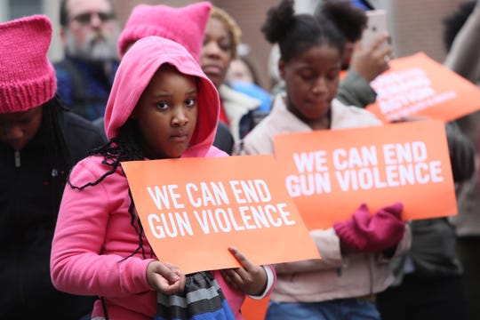 Journey Holmes, 10, holds a sign as she joins the Women's March downtown Memphis on Saturday, Jan. 19, 2019.