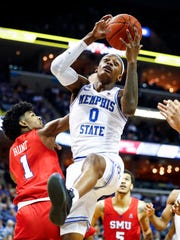 Memphis froward Kyvon Davenport (right) grabs a rebound against SMU defender Feron Hunt (left) during action at the FedExForum, Saturday, January 19, 2019.