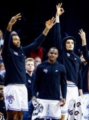 Memphis teammates (left to right) Mike Parks Jr., Alex Lomax, and Isaiah Maurice celebrate on the bench during action against SMU at the FedExForum, Saturday, January 19, 2019.