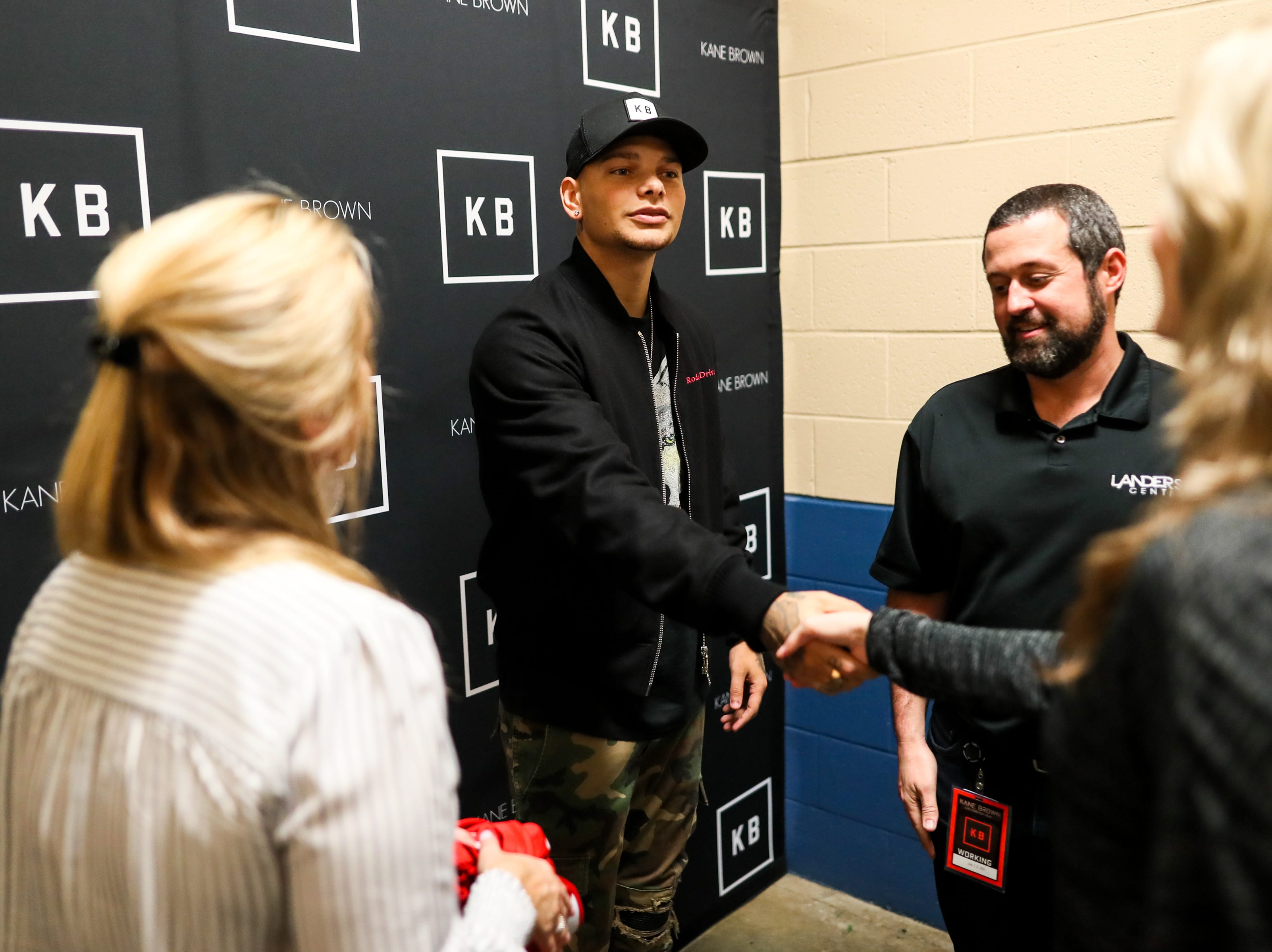 Kane Brown greets fans backstage before his concert at the Landers Center in Southaven, Miss., Friday, Jan. 18, 2019.