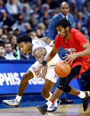 Memphis guard Kareem Brewton Jr. looks to steal the ball away from SMU guard Jimmy Whitt Jr. (right) during action at the FedExForum, Saturday, January 19, 2019.