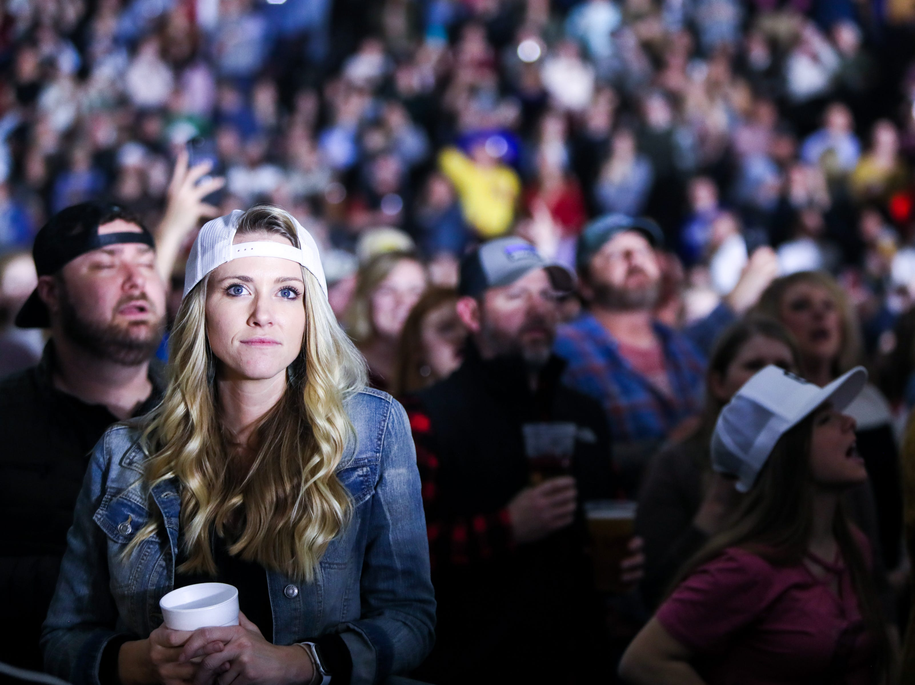Fans watch Kane Brown perform at the Landers Center in Southaven, Miss., Friday, Jan. 18, 2019.