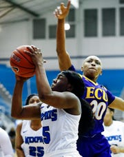 Lady Tigers guard Taylor Barnes (left) drives for a layup against ECU defender Desiree Corbin (right) during action in their conference game at Elma Roane Fieldhouse.