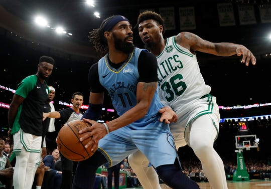 Memphis Grizzlies' Mike Conley (11) looks for a way around Boston Celtics' Marcus Smart during the second half of Boston's 122-116 win in an NBA basketball game Friday, Jan. 18, 2019, in Boston. (AP Photo/Winslow Townson)