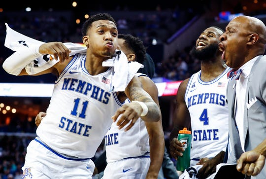 Memphis guard Antwann Jones (left) celebrates on the bench against SMU on Saturday.
