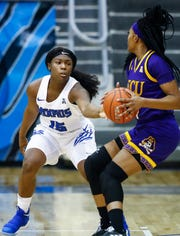 Lady Tigers defender Taylor Barnes (left) applies defensive pressure against ECU guard Necole Hope (right) during action in their conference game at Elma Roane Fieldhouse.