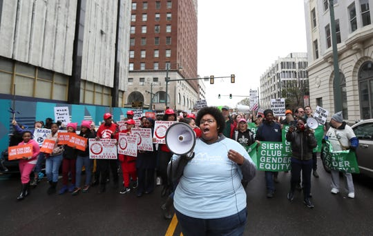 Amber Sherman chants through a megaphone as she leads a group down Adams Avenue during the Women's March downtown Memphis on Saturday, Jan. 19, 2019.