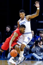 Memphis guard Antwann Jones (right) pressures SMU guard Jahmal McMurray (left) during Saturday's game.