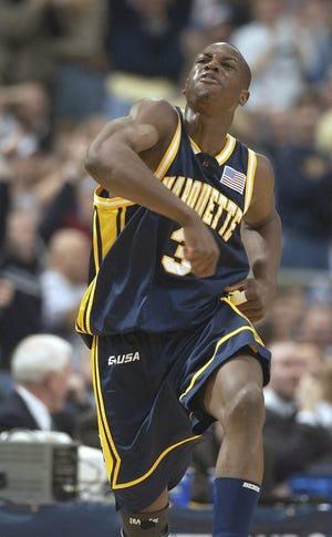 Dwyane Wade is pumped up after hitting a shot during Marquette's victory over Kentucky in the Elite Eight of the 2003 NCAA Tournament.