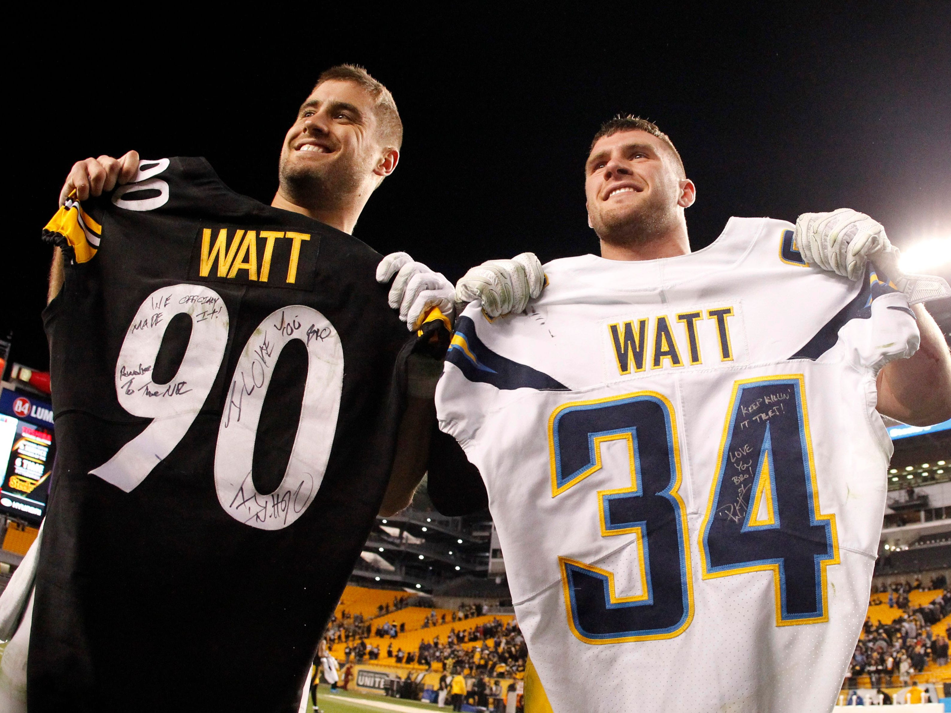 Los Angeles Chargers fullback Derek Watt (left) and Pittsburgh Steelers outside linebacker T.J. Watt exchange jerseys after their game on Dec. 2, 2018, at Heinz Field. The Chargers won 33-30.