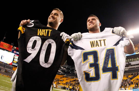 Los Angeles Chargers fullback Derek Watt (left) and Pittsburgh Steelers outside linebacker T.J. Watt exchange jerseys after their game on Dec. 2, 2018, at Heinz Field. The two brothers will reportedly play together next season after Derek signed a three-year deal with the Steelers.