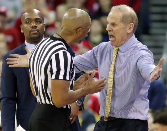 Michigan head coach John Beilein is beside himself as he argues a call with a referee during the second half against Wisconsin on Saturday.