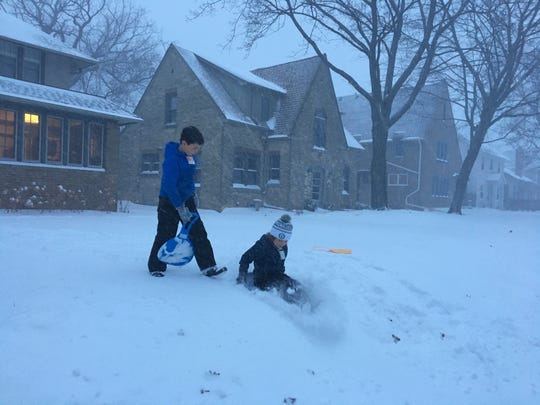 Brothers Sam (left) and Ben Mitich of Shorewood hit the snow early Saturday.